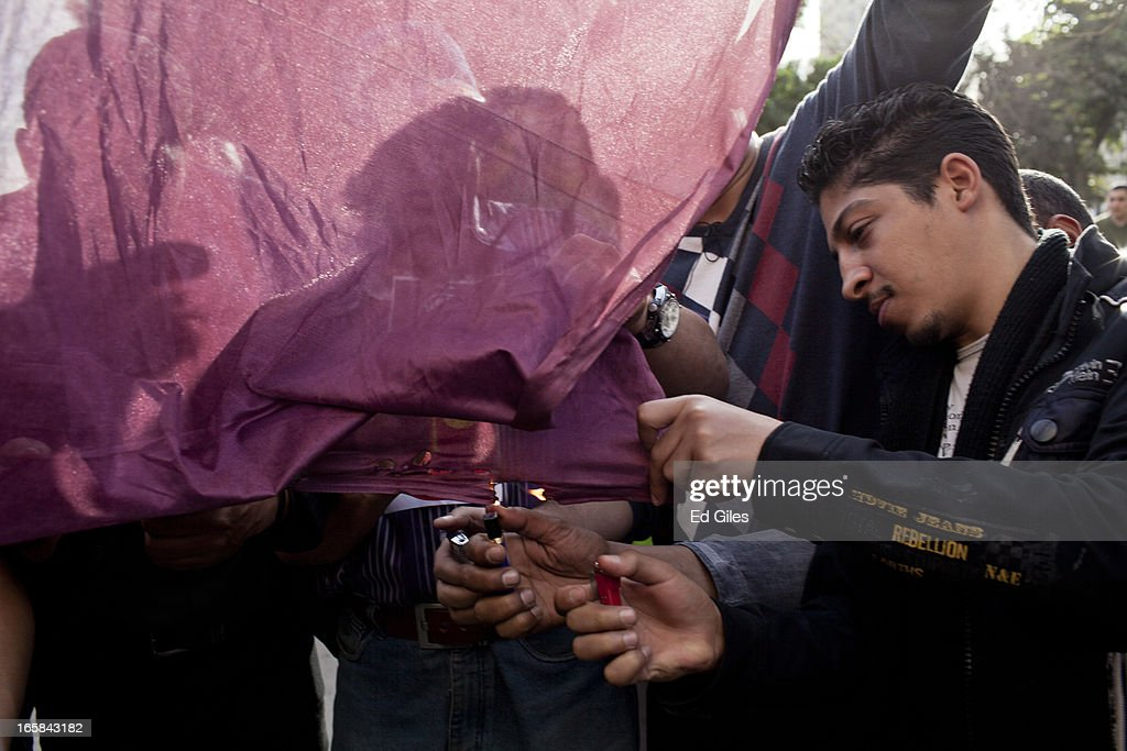 An Egyptian protester attempts to burn a Qatari flag during a demonstration against Egyptian President Mohammed Morsi and the government of the Muslim Brotherhood on April 6, 2013 in Cairo, Egypt. Hundreds of protesters gathered at multiple locations across Cairo and other cities in Egypt to mark the fifth anniversary of the April 6 movement, a major revolutionary group made up of youth and workers in Egypt. (Photo by Ed Giles/Getty Images).