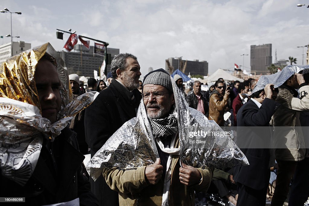An Egyptian protester attends midday prayers shortly after a rain storm during a protest against Egyptian President Mohammed Morsi in Tahrir Square on February 1, 2013 in Cairo, Egypt. Protests continued across Egypt nearly one week after the second anniversary of the Egyptian Revolution that overthrew former President Hosni Mubarak on January 25, 2011. Further protests are expected Friday to commemorate the first anniversary of the Port Said football massace, when over 70 fans of the Cairo-based Al Ahly football club were killed in a violent post-match brawl between fans of the opposing teams inside the Port Said football stadium after a match between the Al Ahly and Al Masry football teams. (Photo by Ed Giles/Getty Images).
