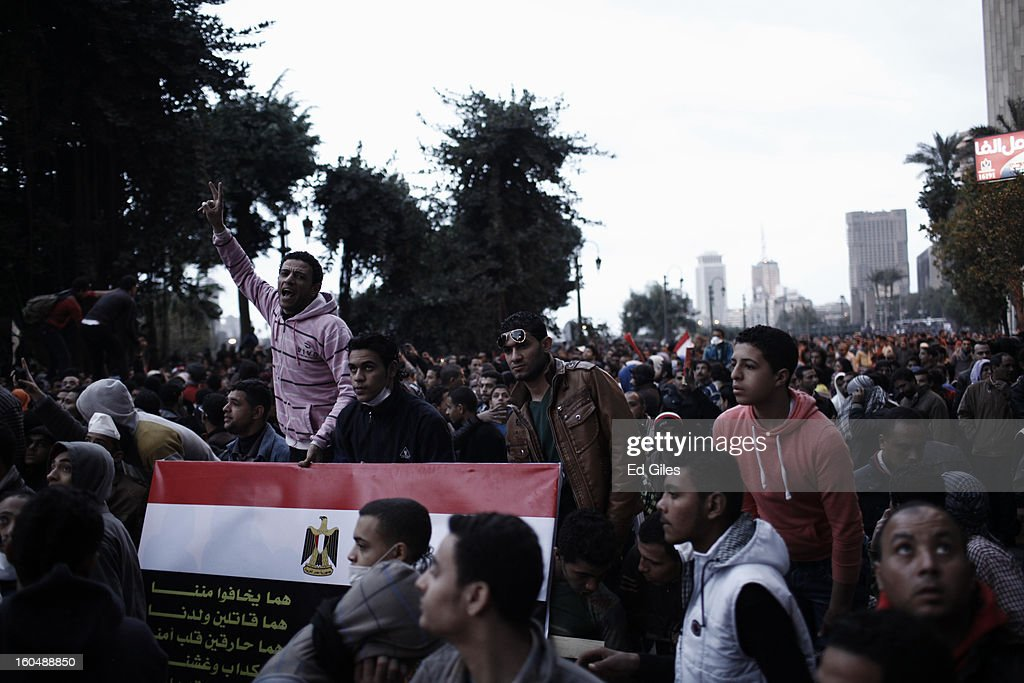 An Egyptian protester chants amongst a crowd during a protest against Egyptian President Mohammed Morsi near Tahrir Square on February 1, 2013 in Cairo, Egypt. Protests continued across Egypt nearly one week after the second anniversary of the Egyptian Revolution that overthrew former President Hosni Mubarak on January 25, 2011. Further protests are expected Friday to commemorate the first anniversary of the Port Said football massacre, when over 70 fans of the Cairo-based Al Ahly football club were killed in a violent post-match brawl between fans of the opposing teams inside the Port Said football stadium after a match between the Al Ahly and Al Masry football teams.