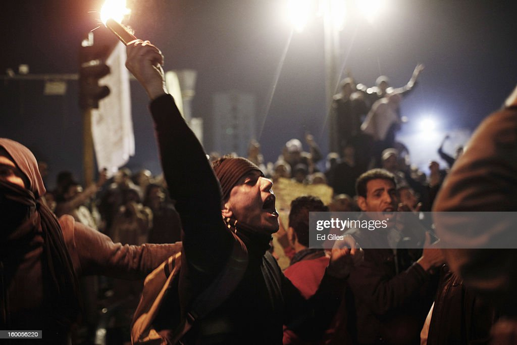 An Egyptian protester chants during a demonstration in Tahrir Square on January 25, in Cairo, Egypt. Thousands of protesters converged on the capital's iconic Tahrir Square on January 25, to mark the second anniversary of the overthrow of former President Hosni Mubarak's regime. (Photo by Ed Giles/Getty Images).