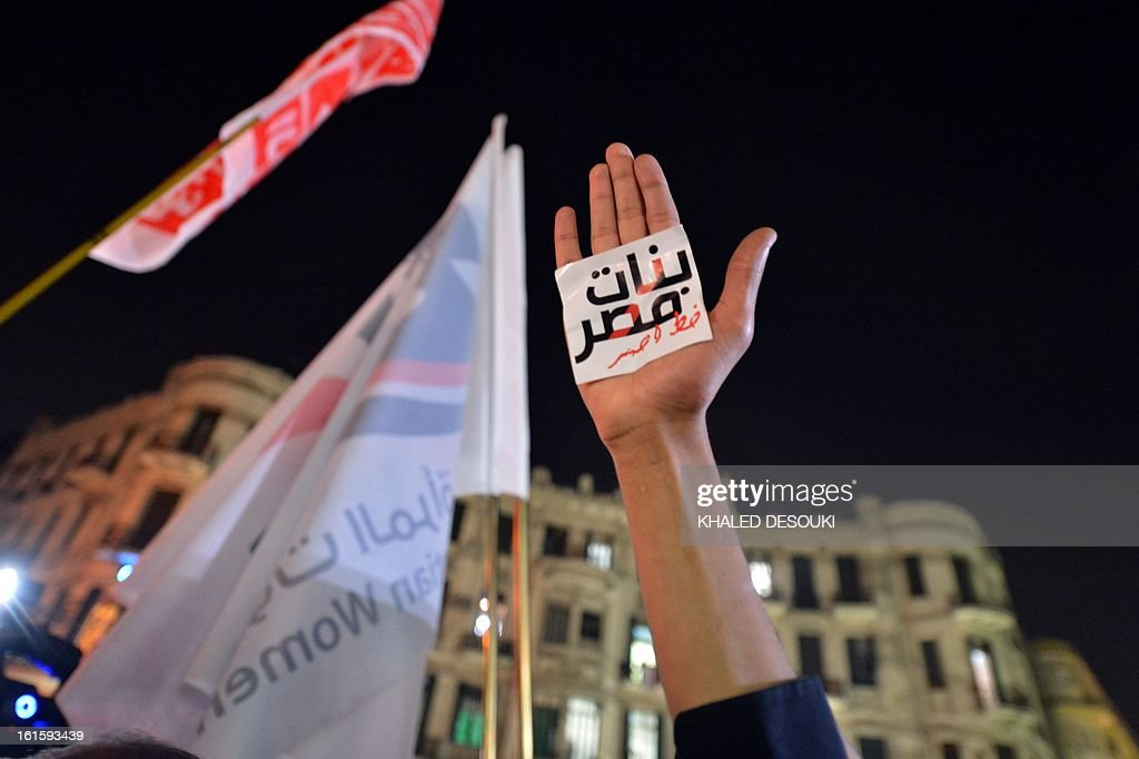 An Egyptian protester hold up his hand with a slogan reading in Arabic 'Egyptian girls are a red line' during a demonstration in Cairo against sexual...