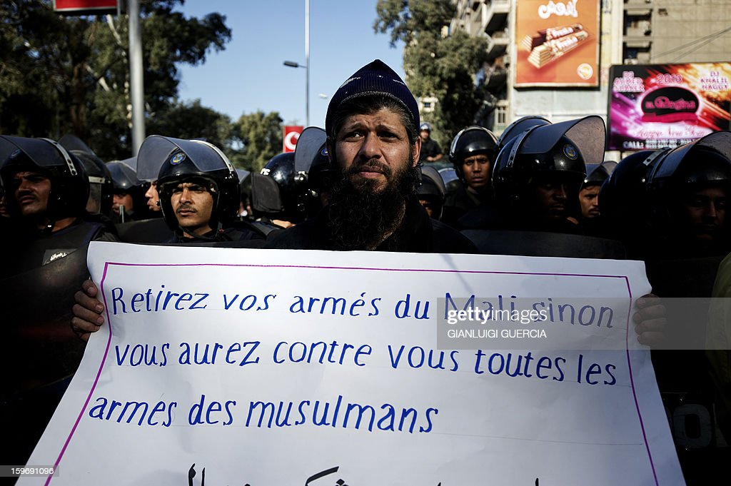 An Egyptian protester holds a banner against France as hundreds of Islamists arrives at the French embassy to protest against the French intervention in Mali on January 18, 2013 in the Egyptian capital Cairo.