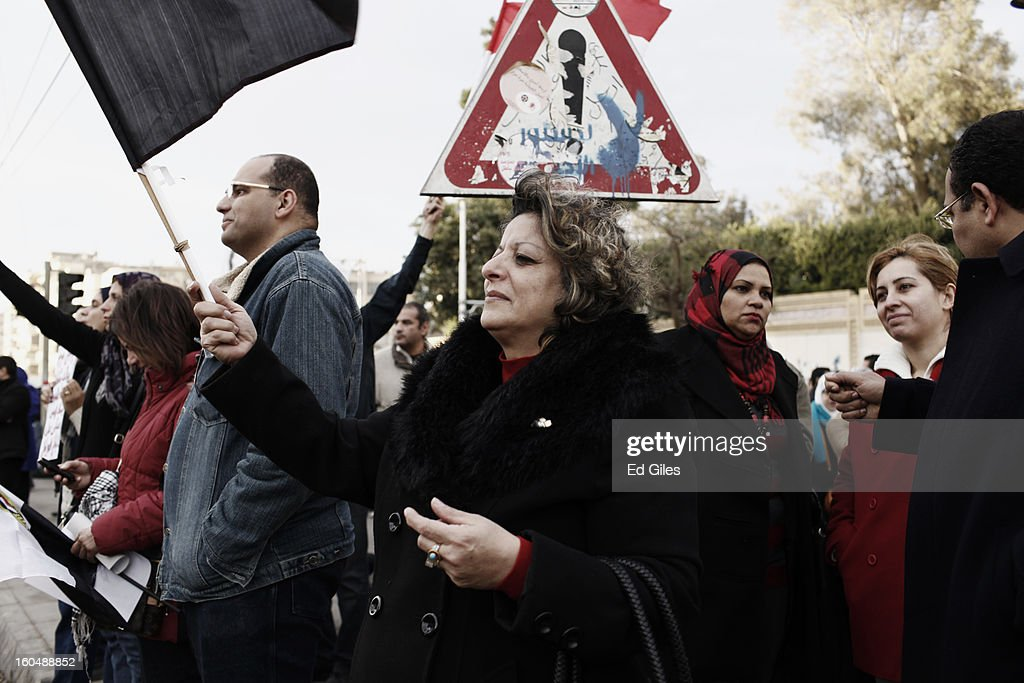 An Egyptian protester holds a flag during anti-government protests outside the Egyptian Presidential Palace in the suburb of Heliopolis on February 1, 2013 in Cairo, Egypt. Protests continued across Egypt nearly one week after the second anniversary of the Egyptian Revolution that overthrew former President Hosni Mubarak on January 25, 2011. Further protests are expected over the weekend to commemorate the first anniversary of the Port Said football massacre, when over 70 fans of the Cairo-based Al Ahly football club were killed in a violent post-match brawl between fans of the opposing teams inside the Port Said football stadium after a match between the Al Ahly and Al Masry football teams.