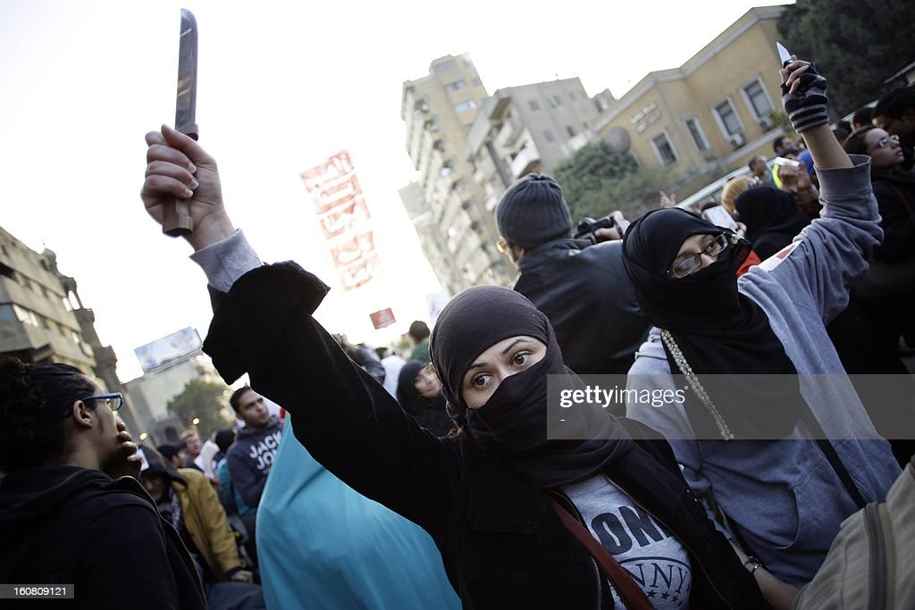 An Egyptian protester holds up a knife during a demonstration to demand an end to sexual violence against women on February 6, 2013 in the Egyptian capital of Cairo. Hundreds of Egyptians took part in the protest, as Amnesty International urged an end to the culture of impunity following harrowing reports of mob attacks in Cairo.