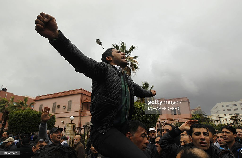 An Egyptian protester shouts slogans against Egypt's President Mohamed Morsi during a demonstration after Friday prayers in Port Said on February 1, 2013. Thousands of Egyptians flooded the streets in a show of opposition to the Islamist President and his Muslim Brotherhood after a week of a wave of deadly unrest swept the country.