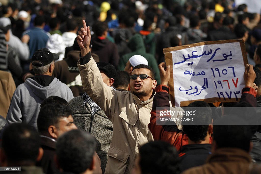 An Egyptian protester shouts slogans against Egypt's President Mohamed Morsi during a demonstration after Friday prayers in the canal city of Port Said on February 1, 2013. Thousands of Egyptians flooded the streets in a show of opposition to the Islamist President and his Muslim Brotherhood after a week of a wave of deadly unrest swept the country.
