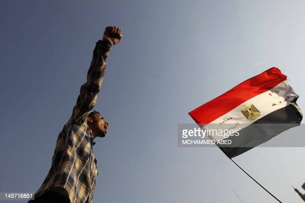 An Egyptian protester shouts slogans against ousted president Hosni Mubarak during a rally in Cairo's Tahrir Square on June 4 2012 Egyptian activists...
