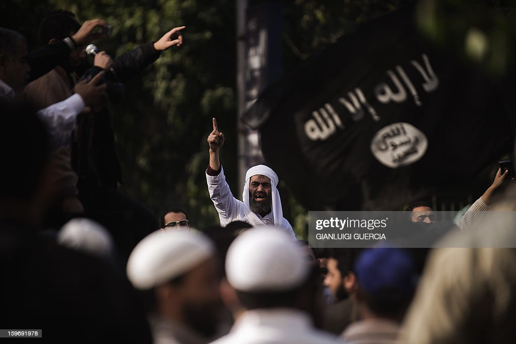 An Egyptian protester shouts slogans during a demonstration organised by Egyptian Islamists against the French intervention in Mali on January 18, 2013 in Cairo. The brother of Al-Qaeda chief Ayman al-Zawahiri joined dozens of Egyptian Islamists in a protest near the French embassy in Cairo.