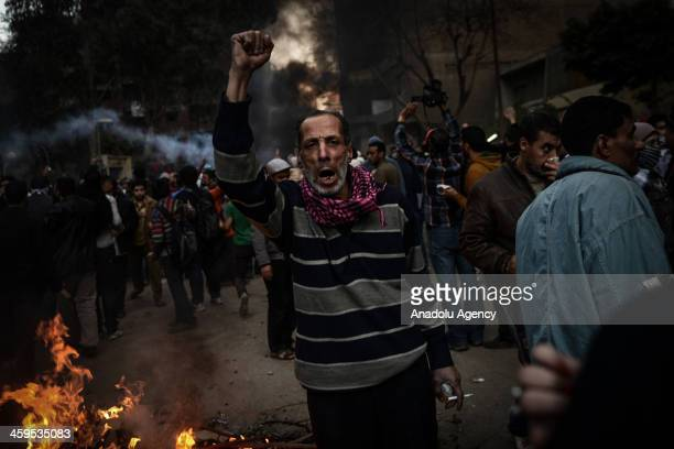 An Egyptian protester shouts slogans during the clashes between Egyptian police and prodemocracy protesters after declaring the Muslim Brotherhood as...
