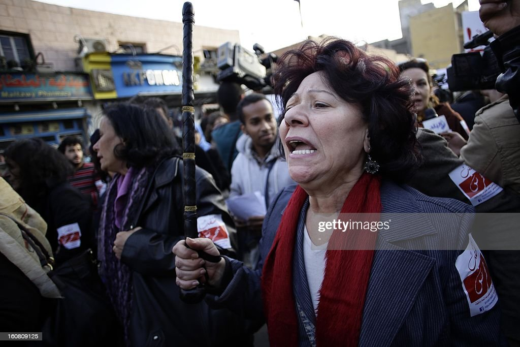 An Egyptian protester shouts slogans holding a police night stick during a demonstration to demand an end to sexual violence against women on February 6, 2013 in the Egyptian capital of Cairo. Hundreds of Egyptians took part in the protest, as Amnesty International urged an end to the culture of impunity following harrowing reports of mob attacks in Cairo.