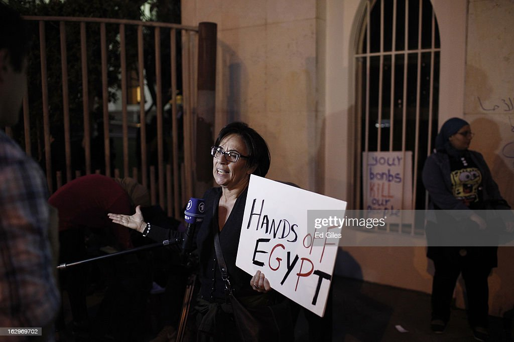 An Egyptian protester speaks with the media during a demonstration at the gates of the Egyptian Foreign Ministry prior to a meeting between United States Secretary of State John Kerry and Egyptian Foreign Minister Mohamed K. Amr on March 2, 2013 in Cairo, Egypt. Secretary of State Kerry is visiting Egypt for two days during an eleven country tour of Europe and the Middle East, marking the first overseas trip by Kerry since assuming the role of Secretary of State.