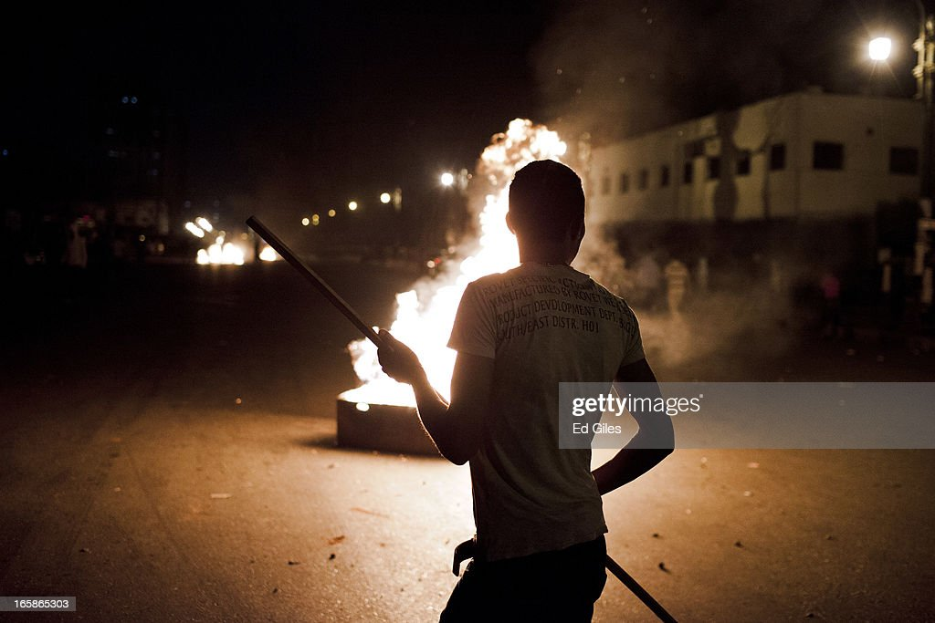 An Egyptian protester stands by a fire during a demonstration against Egyptian President Mohamed Morsi and the government of the Muslim Brotherhood by the Cairo High Court on April 6, 2013 in Cairo, Egypt. Hundreds of protesters gathered at multiple locations across Cairo and other cities in Egypt to mark the fifth anniversary of the April 6 movement, a major revolutionary group made up of youth and workers in Egypt.