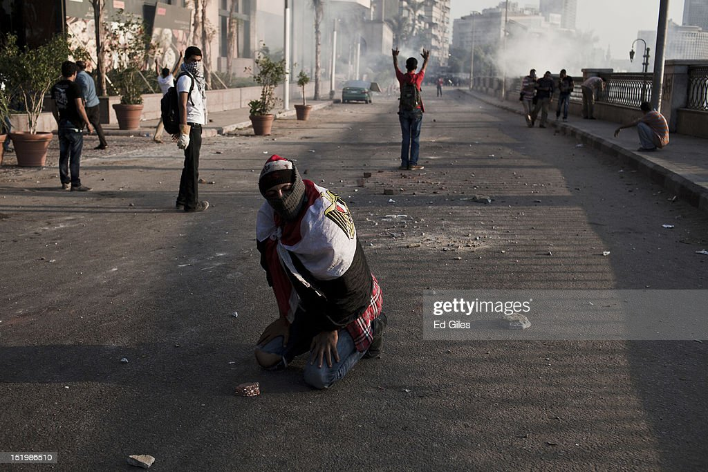 An Egyptian protester suffers from exposure to tear gas fired by riot police during clashes near the United States Embassy on the Nile river corniche on September 14, 2012 in Cairo, Egypt. Over two hundred people have been injured in clashes between protesters and security forces. Protests have continued into a fourth day in central Cairo, with Egyptians demonstrating against a US-made film said to be defaming the Prophet Mohammed, whose trailer had recently been released on Youtube and translated into Arabic. Egyptian authorities began construction of a concrete barrier early Friday morning to stop demonstrations planned across the country for Friday from reaching the US Embassy, after Egyptians demonstrated at the Embassy compound and breached its perimeter walls on Tuesday.