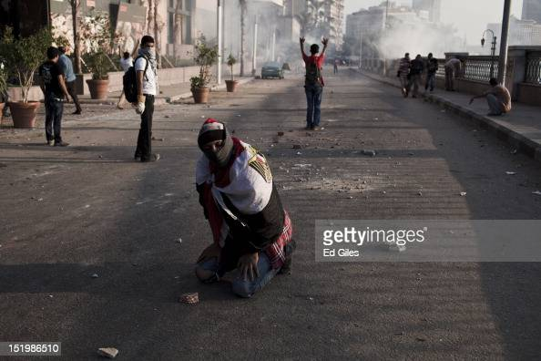 An Egyptian protester suffers from exposure to tear gas fired by riot police during clashes near the United States Embassy on the Nile river corniche...