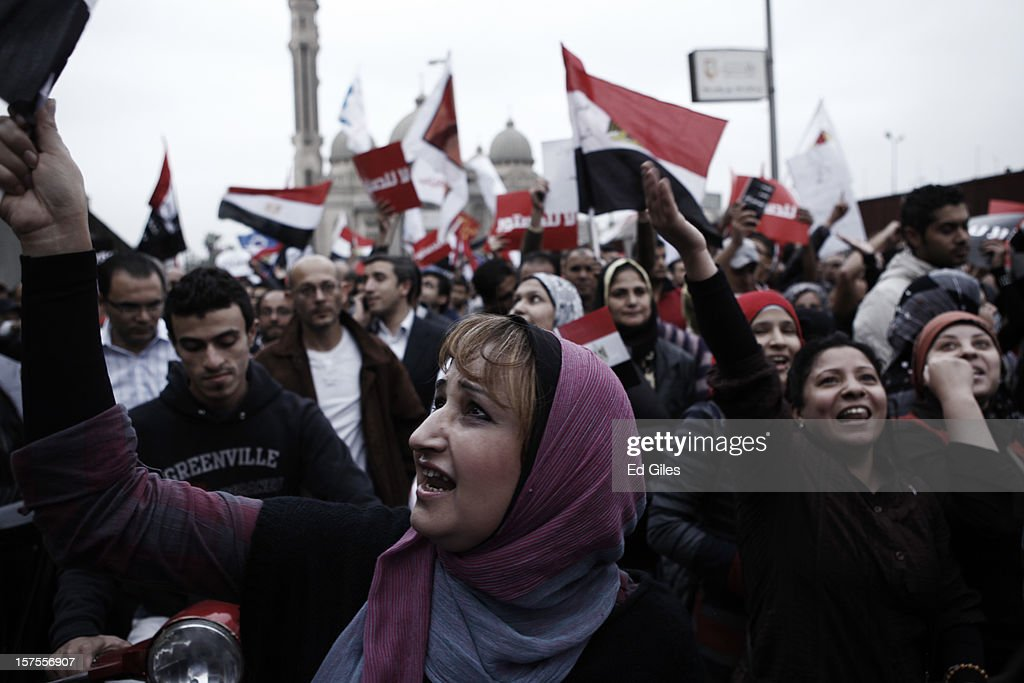 An Egyptian protester takes part in a protest against Egyptian President Mohammed Morsi on December 4 in in Cairo, Egypt. Thousands of protesters converged on the Presidential Palace in the Cairo suburb of Heliopolis on Tuesday evening to demonstrate against the country's draft constitution that was rushed through parliament in an overnight session on November 29. Protesters and police briefly clashed outside the Presidential Palace before riot police retreated inside the palace grounds. The country's new draft constitution, passed by a constitutional assembly dominated by Islamists, will go to a referendum on December 15.