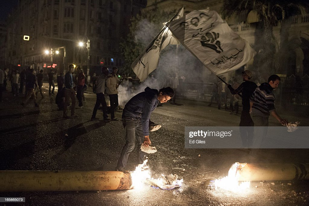 An Egyptian protester tends to a fire during a demonstration against Egyptian President Mohamed Morsi and the government of the Muslim Brotherhood by the Cairo High Court on April 6, 2013 in Cairo, Egypt. Hundreds of protesters gathered at multiple locations across Cairo and other cities in Egypt to mark the fifth anniversary of the April 6 movement, a major revolutionary group made up of youth and workers in Egypt.