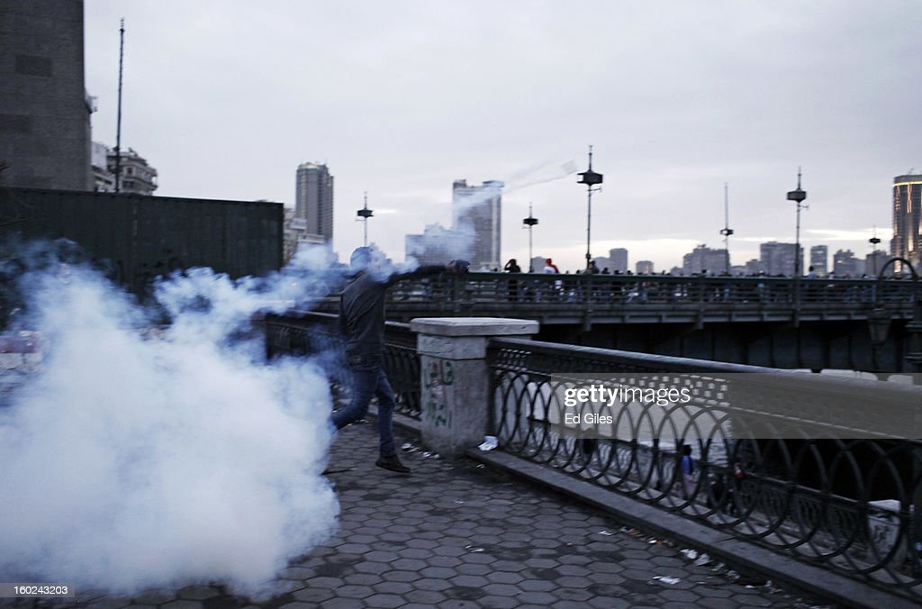 An Egyptian protester throws a live tear gas canister into the Nile river during clashes between protesters and Egyptian riot police near Tahrir Square on January 28, 2013 in Cairo, Egypt. Violent protests continued across Egypt three days after the second anniversary of the Egyptian Revolution that overthrew former President Hosni Mubarak and two days after 21 men were sentenced to death in connection with the deaths of 74 football fans during riots at Port Said stadium one year ago.