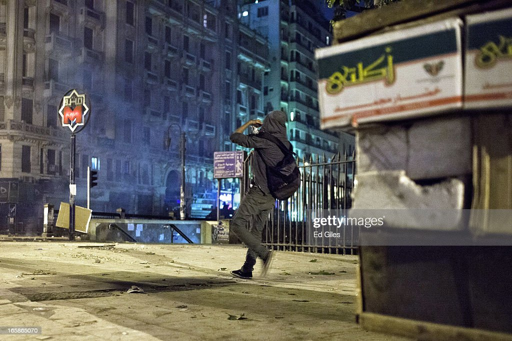An Egyptian protester throws a stone toward nearby riot police during a demonstration against Egyptian President Mohamed Morsi and the government of the Muslim Brotherhood by the Cairo High Court on April 6, 2013 in Cairo, Egypt. Hundreds of protesters gathered at multiple locations across Cairo and other cities in Egypt to mark the fifth anniversary of the April 6 movement, a major revolutionary group made up of youth and workers in Egypt.