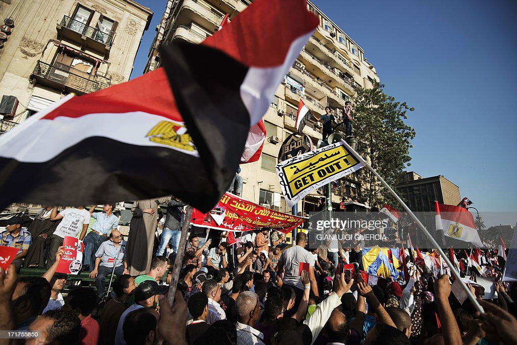 An Egyptian protester waves the national flag during a demonstration against president Mohamed Morsi and the Muslim Brotherhood in Egypt's landmark Tahrir square on June 28, 2013. Supporters and opponents of Egyptian Islamist President Mohamed Morsi took to the streets for rival protests a year after his election, as clashes in Alexandria raised fears of widespread unrest.