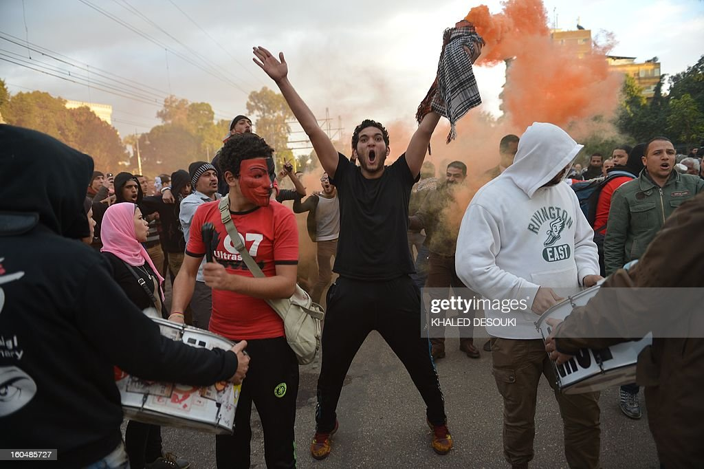 An Egyptian protestershouts slogans during a demonstration in opposition to Morsi and his Muslim Brotherhood in front of the Presidential palace in Cairo on February 1, 2013. Egyptian security used water cannon and fired shots into the air as protesters threw petrol bombs and stones into the grounds of the presidential palace, an AFP correspondent said.