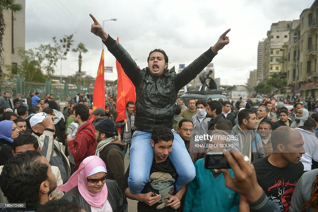 An Egyptian protestor shouts slogans against Egypt's President Mohamed Morsi during a march to the presidential palace in Cairo on February 1, 2013. Thousands of Egyptians flooded the streets in a show of opposition to the Islamist President and his Muslim Brotherhood.