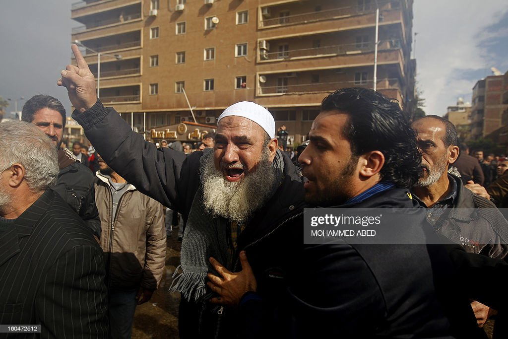 An Egyptian protestor shouts slogans against Egypt's President Mohamed Morsi during a demonstration after Friday prayers in the canal city of Port Said on February 1, 2013. Thousands of Egyptians flooded the streets in a show of opposition to the Islamist President and his Muslim Brotherhood after a week of a wave of deadly unrest swept the country.
