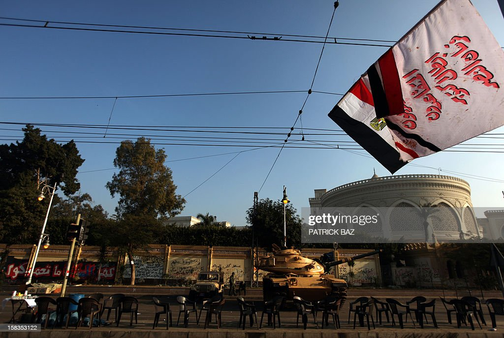 An Egyptian Republican Guard tank is stationed outside the presidential palace in Cairo on December 14, 2012. Weeks of protests and violent clashes between rival camps that left eight people dead last week have failed to dissuade Egypt's President Mohamed Morsi from holding the referendum, which will be staggered over a week.