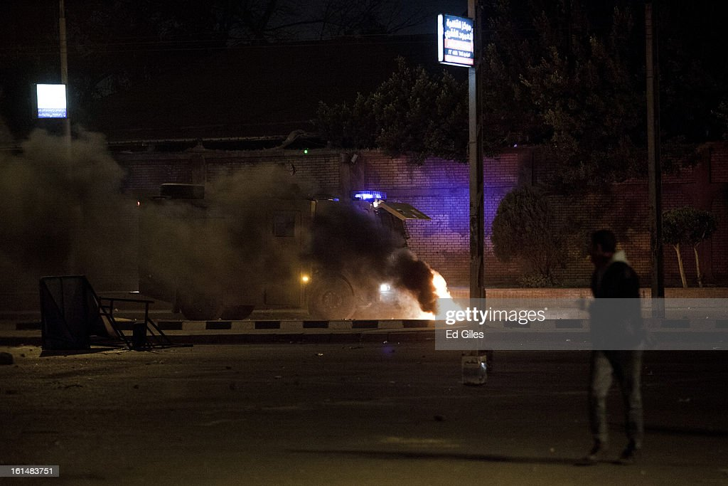 An Egyptian riot police armoured vehicle tries to run over a burning tire in the road while approaching protesters during violent protests by the Presidential Palace in Heliopolis, February 11, 2013 in Cairo, Egypt. Protests continued across Egypt against President Morsi and the Muslim Brotherhood on the 2nd anniversary of former President Hosni Mubarak stepping down, and over two weeks after the second anniversary of the Egyptian Revolution beginning on January 25, 2011. (Photo by Ed Giles/Getty Images).