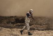 An Egyptian security force runs after they hit some houses in Rafah near the border with southern Gaza Strip October 30 2014 Egypt began setting up a...