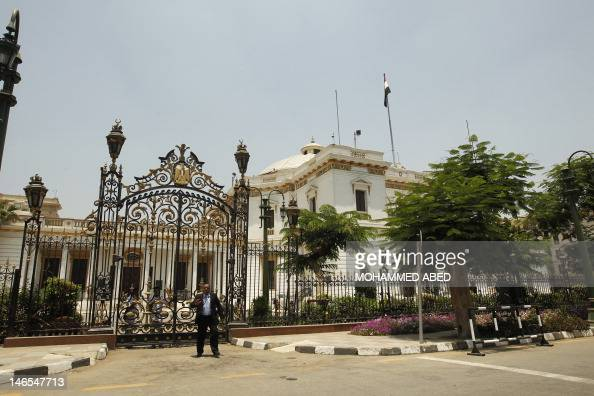 An Egyptian security guard stands in front of the parliament building as police block the road to prevent members of the recentlyscrapped...