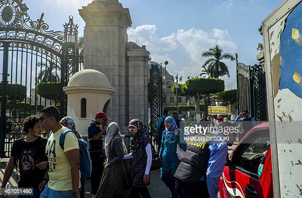 An Egyptian security man from a private company stops a vehicle at the gates of Cairo University in the Egyptian capital on October 11 as students...