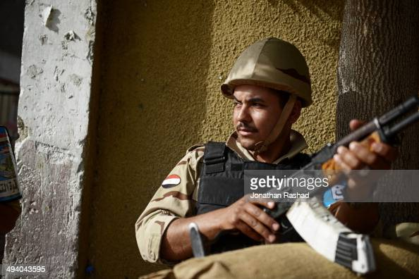 An Egyptian soldier sits armed outside a polling station in the Cairo suburb of Rod ElFarag on May 27 2014 Egypt will hold Presidential elections on...