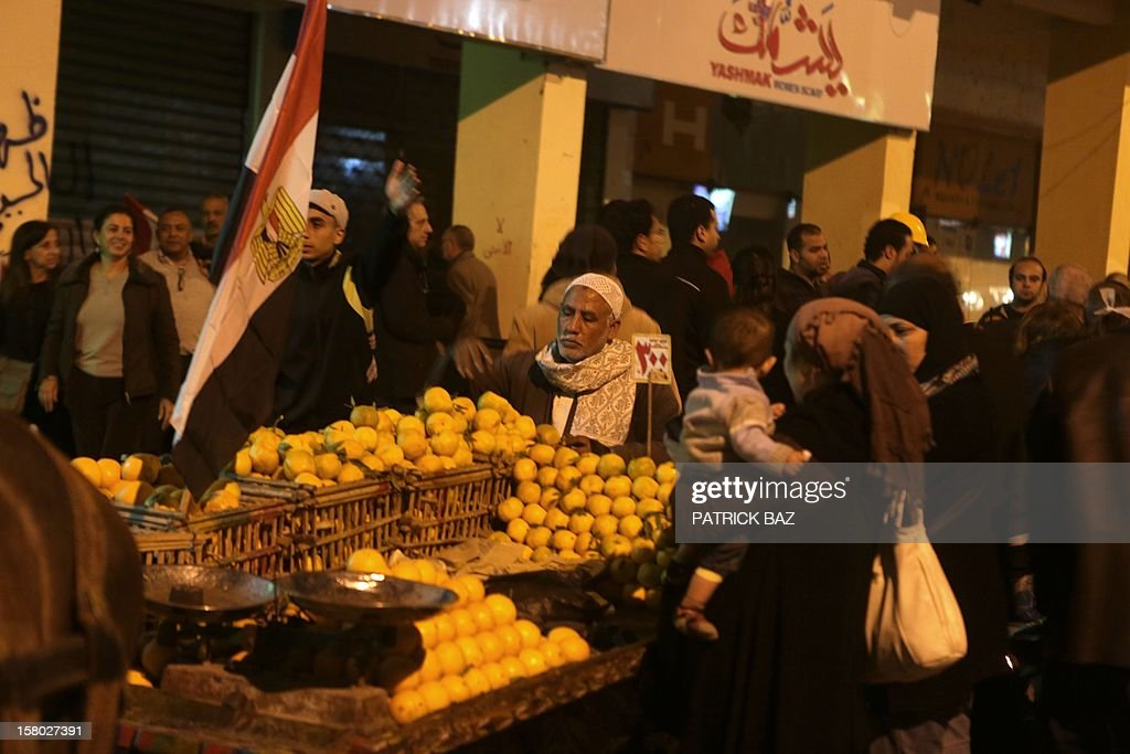 An Egyptian street vendor sells lemons to protesters during a demonstration outside Egyptian presidential palace against President Mohamed Morsi on December 9, 2012 in Cairo. Egypt's opposition called for mass street protests rejecting a December 15 referendum on a new constitution largely drafted by President Mohamed Morsi's Islamist allies.
