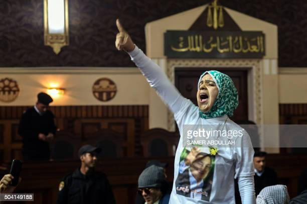 An Egyptian supporter of ousted president Hosni Mubarak reacts inside the courtroom in Cairo on January 9 after top appeals court upheld upheld a...