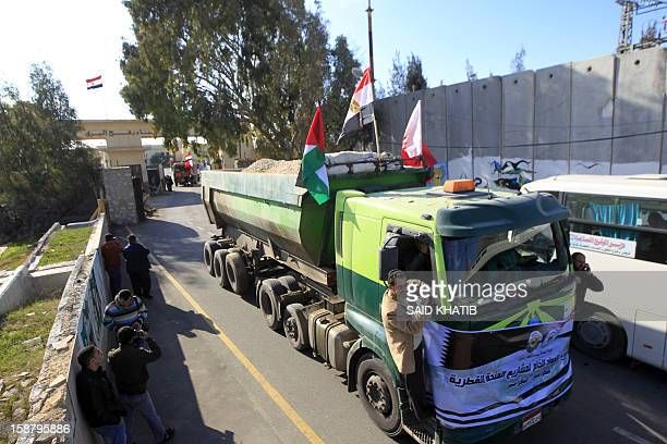 An Egyptian truck loaded with gravel enters through the Rafah border crossing between Egypt and Gaza Strip in the southern Gaza Strip on December 29...