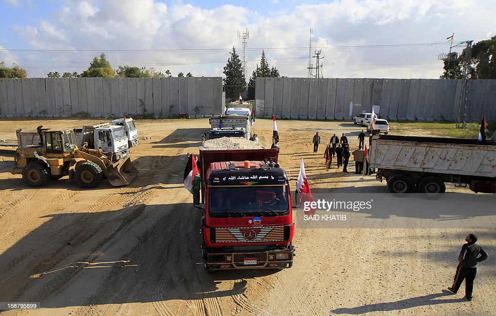 An Egyptian truck loaded with gravel enters through the Rafah border crossing, between Egypt and Gaza Strip, in the southern Gaza Strip on December 29, 2012 as building material for the Qatari grant projects begin arriving. In October, the emir made a landmark trip to the Gaza Strip, the first such visit by a head of state since the Islamist movement Hamas took over the territory in 2007. AFP PHOTO / SAID KHATIB