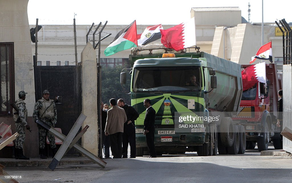An Egyptian truck loaded with gravel prepares to enter through the Rafah border crossing, between Egypt and Gaza Strip, in the southern Gaza Strip on December 29, 2012 as building material for the Qatari grant projects begin arriving. In October, the emir made a landmark trip to the Gaza Strip, the first such visit by a head of state since the Islamist movement Hamas took over the territory in 2007.