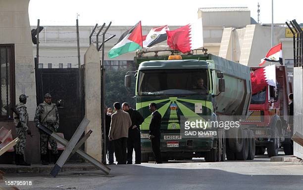 An Egyptian truck loaded with gravel prepares to enter through the Rafah border crossing between Egypt and Gaza Strip in the southern Gaza Strip on...