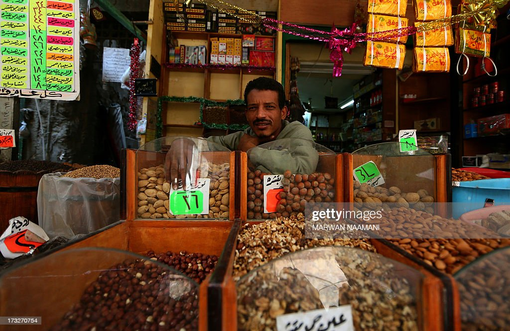 An Egyptian vendor waits for customers at his shop in the popular Saida Zeinab district of Cairo on the second day of the holy month of Ramadan on July 11, 2013. Many Egyptians are marking Ramadan, where Muslims abstain from eating and drinking from dawn to dusk, as uncertainty riddles the country amid soaring tension following last weeks' toppling of Islamist president Mohamed Morsi. AFP PHOTO/MARWAN NAAMANI