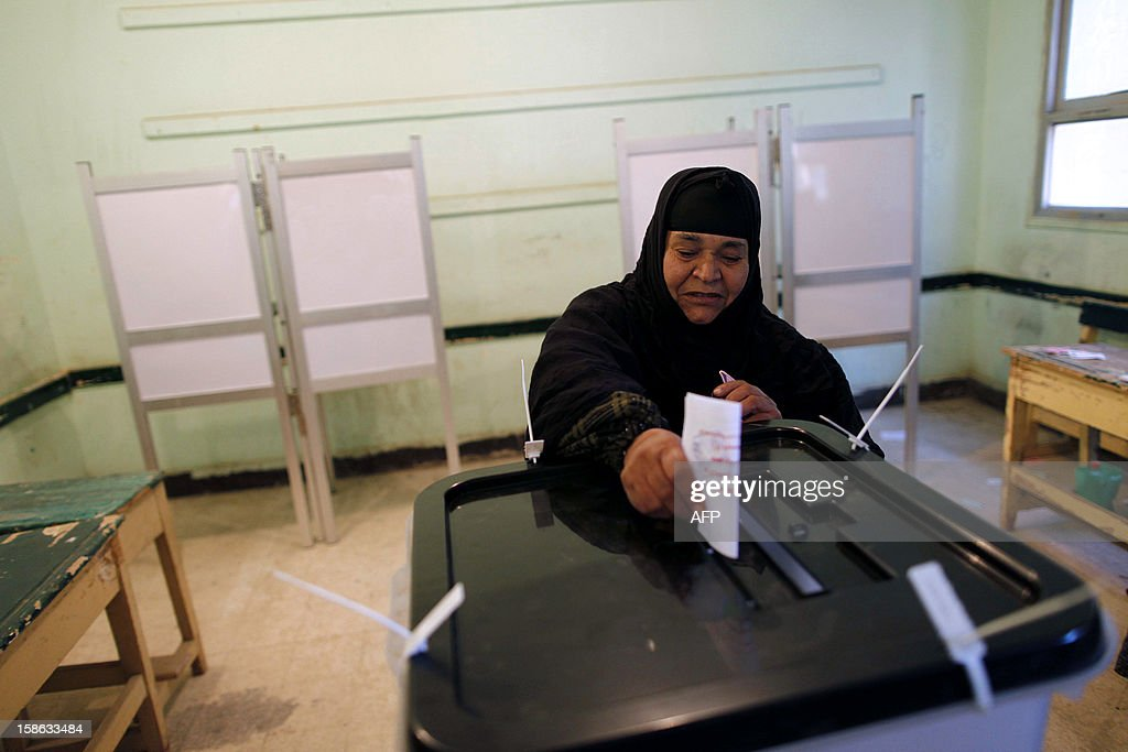 An Egyptian woman casts her ballot at a polling station during the second round of a referendum on a new draft constitution in Beni Sueif, south of Cairo, on December 22, 2012. Egyptians are voting in the final round of a referendum on a new constitution championed by President Mohamed Morsi and his Islamist allies against fierce protests from the secular-leaning opposition.