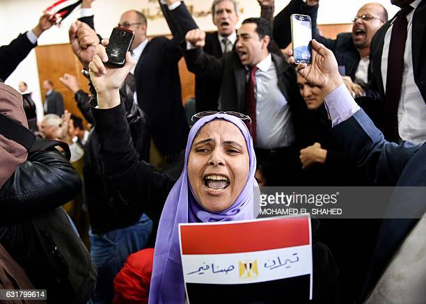 An Egyptian woman celebrates with a national flag defaced with the words 'Tiran' and 'Sanafir' after the High Administrative Court upheld on January...