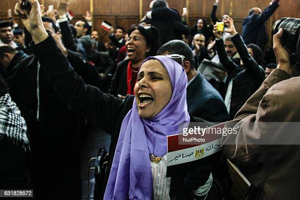 An Egyptian woman celebrates with a national flag defaced with the words quotTiranquot and quotSanafirquot after the High Administrative Court upheld...