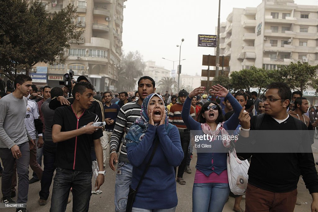 An Egyptian woman chants anti-government slogans during a demonstration at the headquarters of the Muslim Brotherhood on March 22, 2013 in Cairo, Egypt. Opposition demonstrators converged on the headquarters of the Muslim Brotherhood in the Cairo suburb of Muqattam to protest against the government of President Mohammed Morsi, who is closely connected to the Muslim Brotherhood movement.