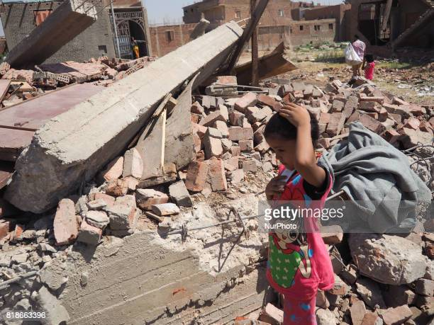 An Egyptian woman children family standing in front of a destroyed house in alWarraq Island Giza Egypt 18 July 2017 Clashes broke at the island of...