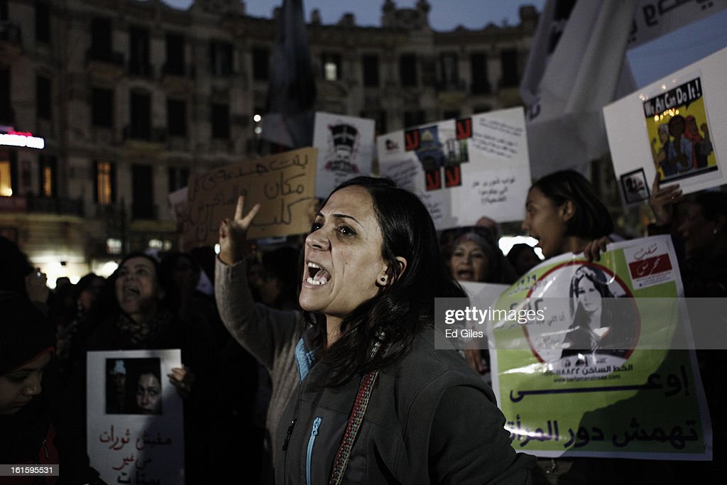 An Egyptian woman leads other protesters in chants during a march against sexual harassment at Talat Harb Square, on February 12, 2013 in central Cairo, Egypt. A few hundred Egyptian men and women gathered at the Egyptian capital's Talat Harb Square on Tuesday to demonstrate against the continuing problem of sexual harassment of Egyptian and foreign women during demonstrations across Egypt. (Photo by Ed Giles/Getty Images).