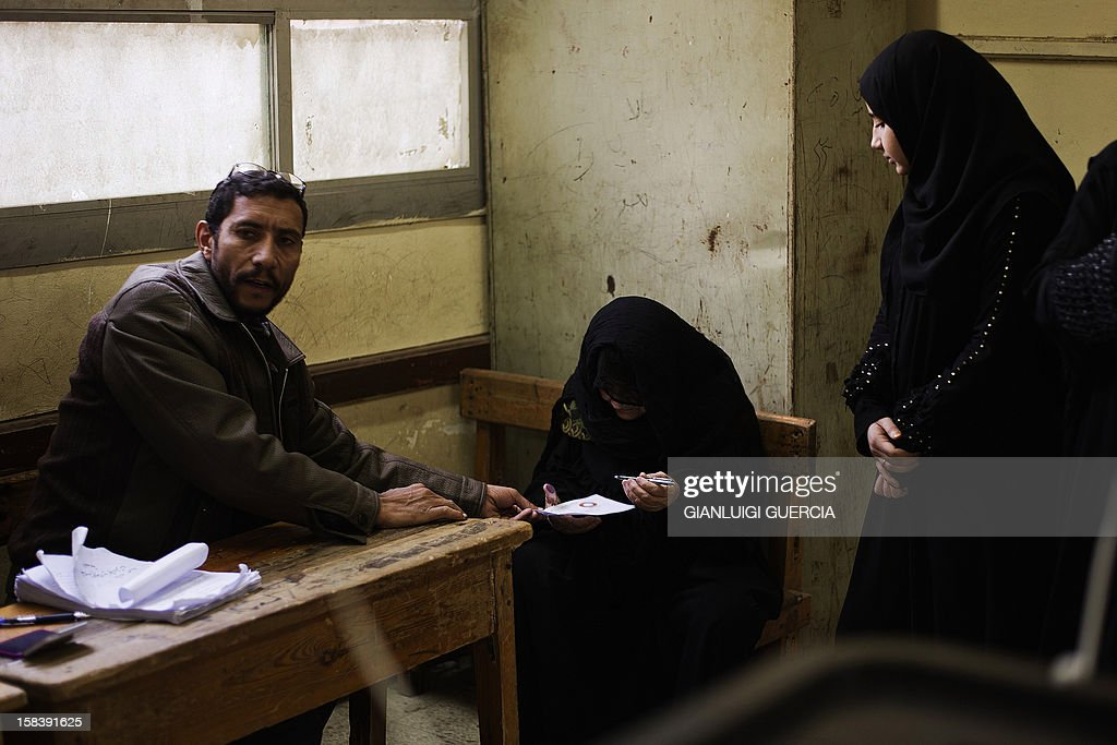 An Egyptian woman marks her ballot before casting her vote in a referendum on a new constitution at a polling station in President Mohamed Morsi's hometown Adwa in the Nile Delta on December 15, 2012. Egypt's opposition cried fraud in the first round of a divisive referendum on a new constitution, accusing Morsi's Muslim Brotherhood of rigging votes to adopt the Islamist-backed text.