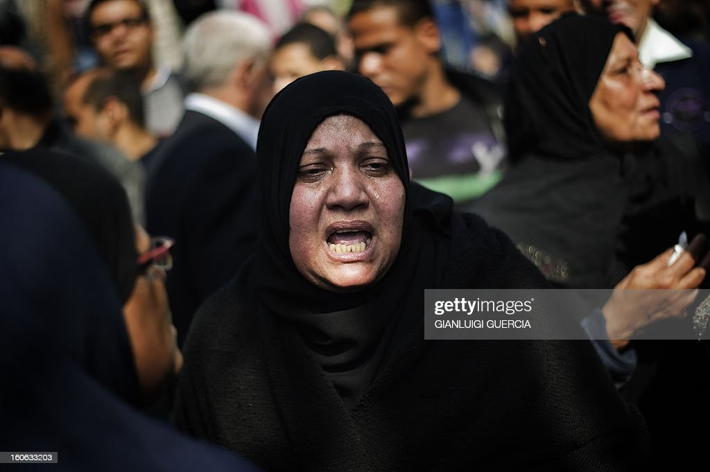 An Egyptian woman reacts during the funeral of killed Egyptian activists Amro Saad and Mohammed al-Guindi outside Omar Makram Mosque in Cairo's Tahrir Square on February 4, 2013. Saad died in clashes during anti-government protests on February 1, while Guindi, 28, went missing last month after joining protests demanding change on the second anniversary of Egypt's uprising against former president Hosni Mubarak and then slipped into a coma following days in police custody, according to the health ministry and his party.