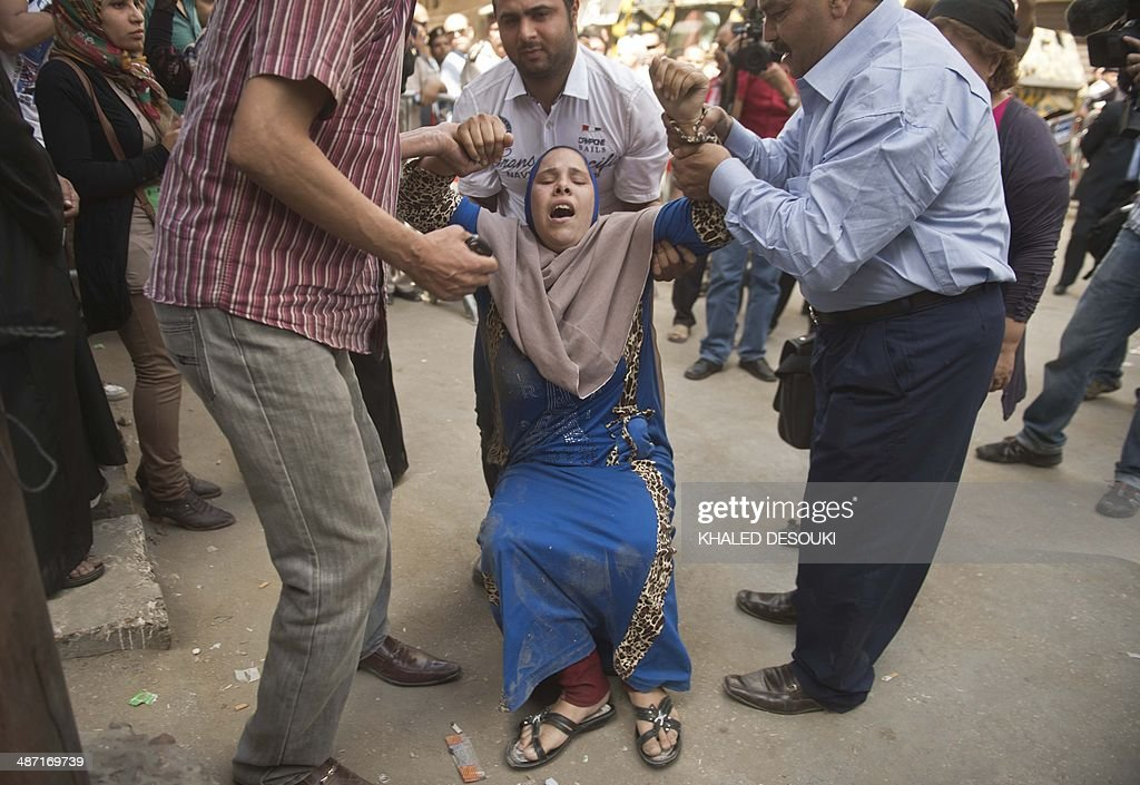 An Egyptian woman reacts outside the courtroom in Egypt's southern province of Minya after an Egyptian court sentenced Muslim Brotherhood leader Mohamed Badie and other alleged Islamists to death on April 28, 2014. The defendants were accused of involvement in the murder and attempted murder of policemen in Minya province on August 14, the day police killed hundreds of ousted Islamist president Mohamed Morsi's supporters in clashes in Cairo.