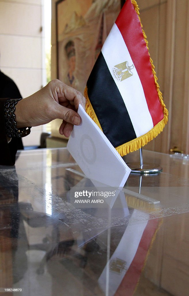 An Egyptian woman residing in Lebanon votes on a divisive draft constitution at the Egyptian embassy in Beirut on December 12, 2012. The expatriate vote -- itself postponed for days -- began with the polling of more than 500,000 Egyptians at embassies and consulates in 150 countries, Egypt's official news agency MENA said as the country's charter pitted Islamist allies of President Mohammed Morsi against secular-leaning foes in rival rallies that clashed last week. AFP PHOTO/ANWAR AMRO