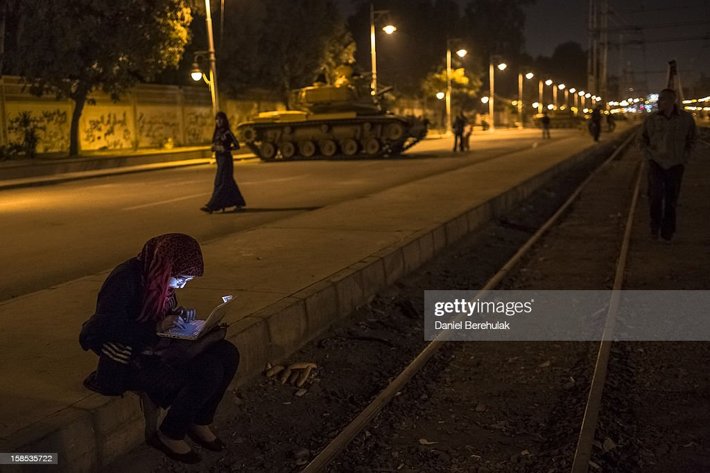 An Egyptian woman types on her laptop prior to the start of a demonstration opposing president Mohammed Morsi at the Presidential Palace on December 18, 2012 in Cairo, Egypt. Hundreds of people gathered in front of the Presidential Palace and in Tahrir Square to protest against President Mohammed Morsi and the alleged rigging of the first round of voting in the constitutional referendum.